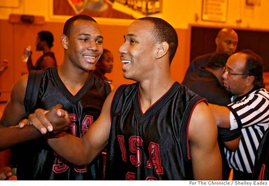 Twin brothers Marseilles Stewart, left #33 and Dominic Stewart, right #24 celebrate after International Studies Acadamy High's win against Half Moon High. ISA won 78 to 46.  Shelley Eades/ The Chronicle /mandatory credit photog Mags out. Photo: Shelley Eades