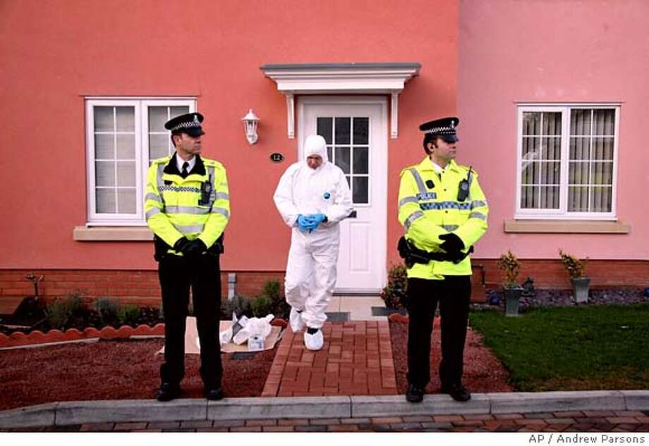 Forensic officers search a house in Eye, England, Monday, Dec. 18, 2006 following the arrest of a 37-year-old man in Trimley St Martin, after the deaths of 5 girls in Ipswich. Police hunting a suspected serial killer following the murders of five prostitutes in eastern England arrested a 37-year-old man on Monday. (AP Photo/Andrew Parsons, PA) ** UNITED KINGDOM OUT NO ARCHIVE ** Photo: ANDREW PARSONS