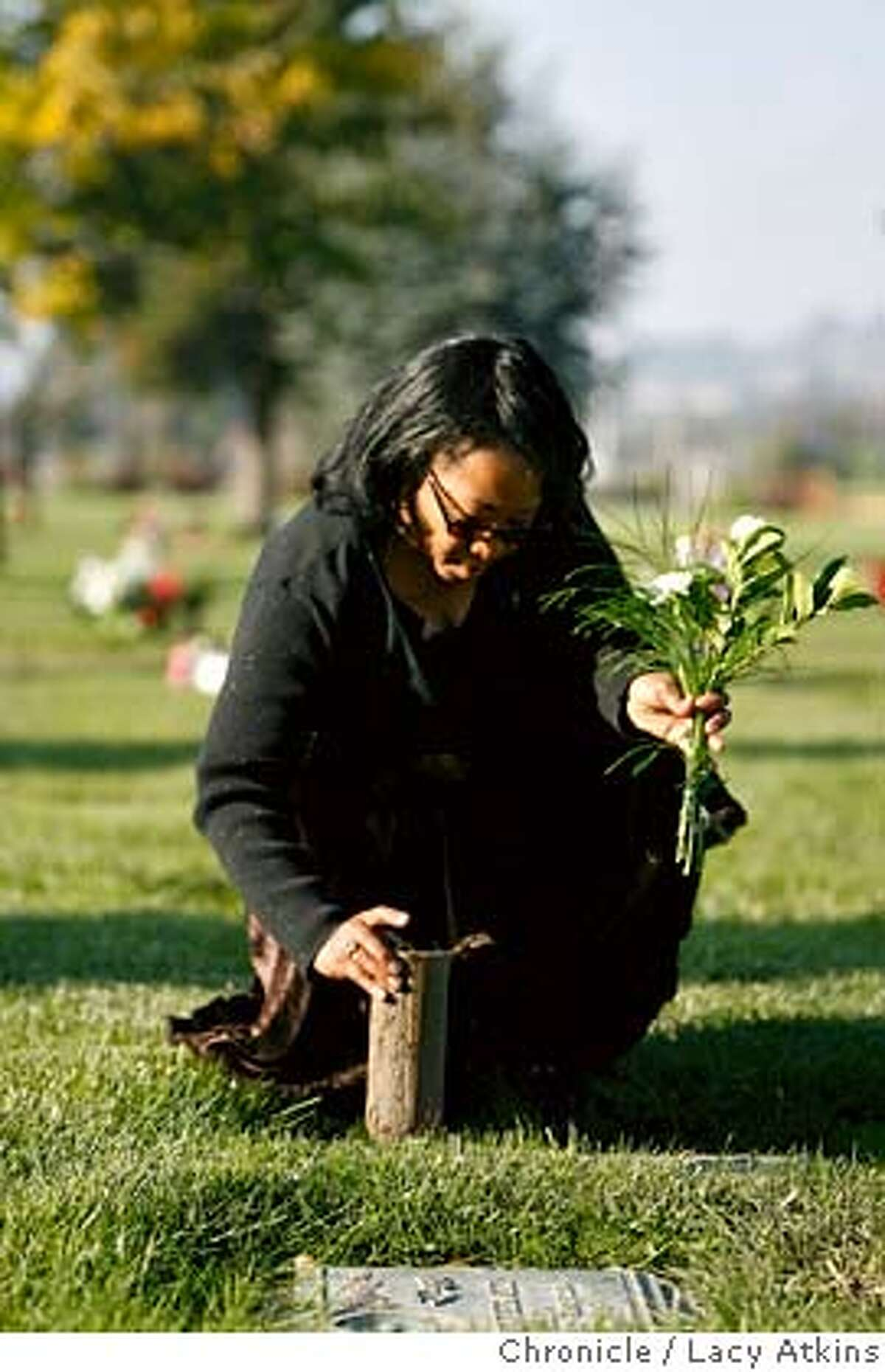 Lorrain Taylor visits her sons grave at the Chapel of the Chimes Memorial Park, Sunday Dec. 3, 2006, in Hayward, Ca. Because they are buried here, she remains in the bay area rather than near her other living son, Gregory, in Houston. Her twin sons Albade and Obadiah were killed in February of 2000. (Lacy Atkins / The Chronicle)