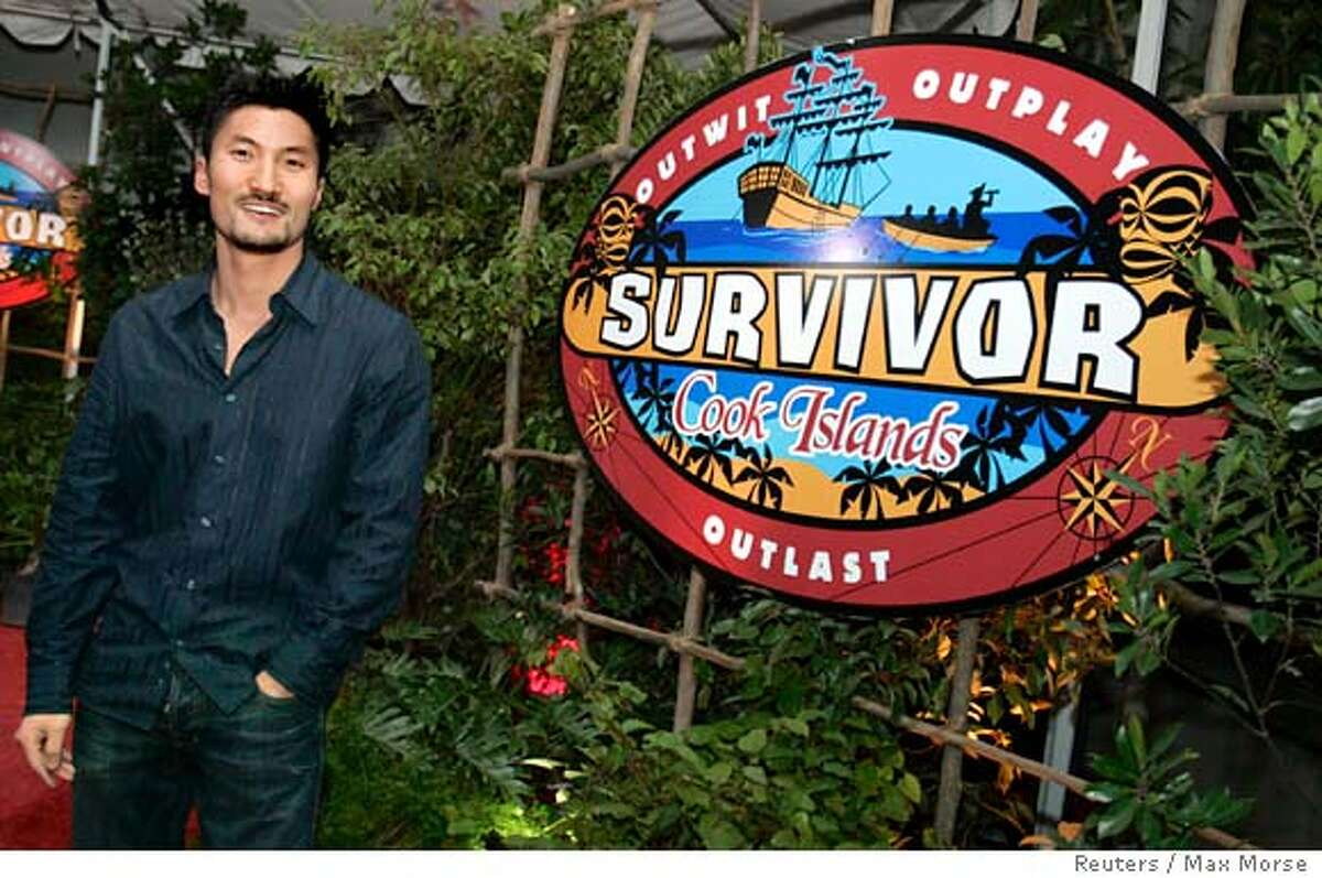 Yul Kwon, the winner of 'Survivor: Cook Islands', poses for photographers after taping the show's season finale in Los Angeles December 17, 2006. REUTERS/Max Morse (UNITED STATES)