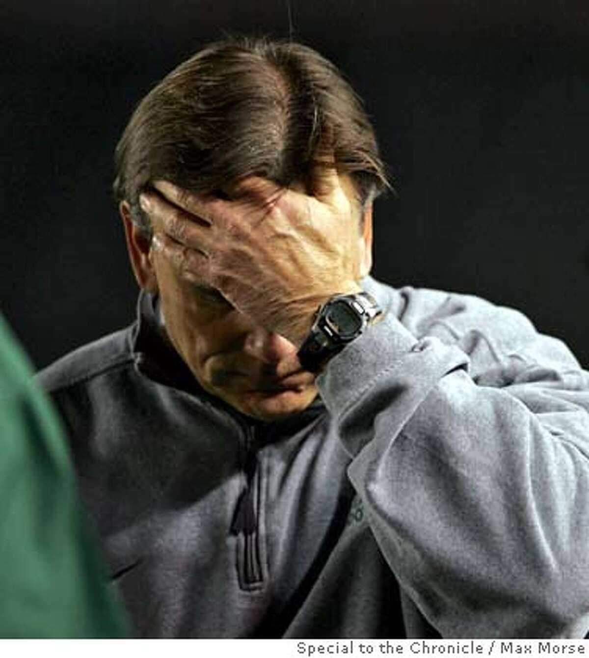 HH0S0883.JPG STATE CHAMPS De La Salle coach Bob Ladoceur touches his head against Canyon in the 2006 Division I CIF State Football Championship Bowl Game at the Home Depot Center in Carson, CA December 16, 2006. By MAX MORSE/SPECIAL TO THE CHRONICLE