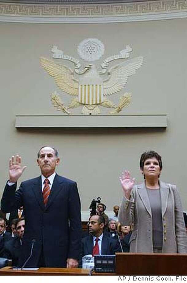 Ousted HP Chairwoman Patricia Dunn, right, and Larry W. Sonsini, chairman of Wilson Sonsini Goodrich and Rosati, are sworn in before their testimony at the House Energy and Commerce Committee hearing on Capitol Hill in Washington Thursday, Sept. 28, 2006. Lawmakers denounced the intrusive tactics used in Hewlett-Packard Co.'s spying probe as a congressional hearing opened Thursday with stark comparisons between the tawdry affair and the 67-year-old company's reputation for integrity. (AP Photo/Dennis Cook)  Ran on: 10-01-2006  Larry Sonsini and former HP chairwoman Patricia Dunn testify before a congressional committee.  Ran on: 10-01-2006  Larry Sonsini and former HP Chairwoman Patricia Dunn testify before a congressional committee. Photo: DENNIS COOK
