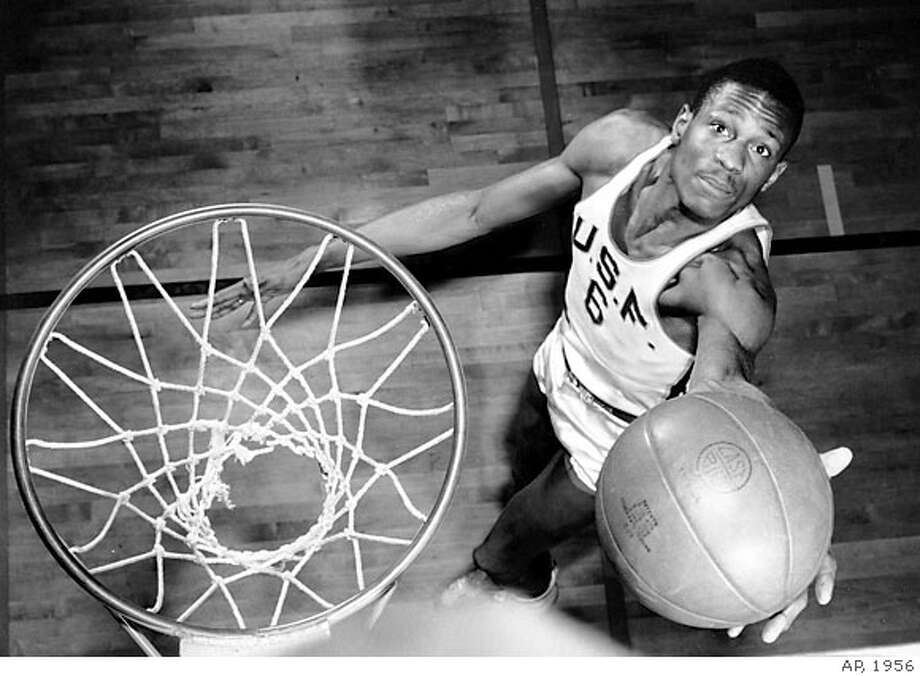 """The Oakland Museum of California's """"Sports: Breaking Records, Breaking Barriers"""" highlights 35 history-making athletes who changed the world of sports including William (Bill) Russell, pictured here in an image taken in 1956 at USF. The exhibit runs through Jan. 7. Photo Credit: AP/Wide World Photos. Ran on: 10-01-2006  Take a San Francisco Duck Tour, a land and sea adventure on one of Bay Quackers' original, refurbished World War II amphibious landing craft. Photo: AP/Wide World Photos"""