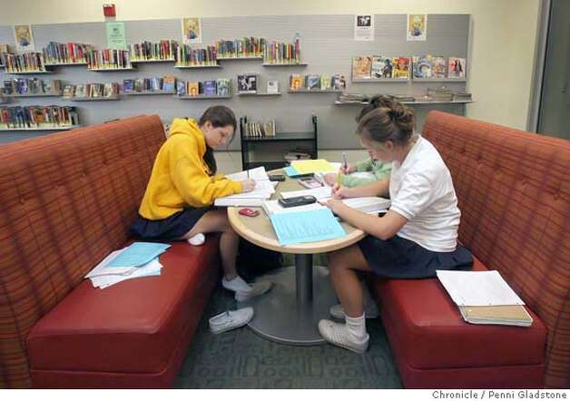 LIBRARIES17  Studing for a final at the Belmont library are Notre Dame high school students, left Carolyn Giannini age 17, in white is Brittany Thayer age 17, and behind Thayer is Roxanne Loo age 16.  Event on 12/14/06 in San Mateo.  Penni Gladstone / The Chronicle MANDATORY CREDIT FOR PHOTOG AND SF CHRONICLE/ -MAGS OUT Photo: Penni Gladstone