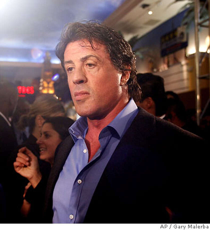 "Actor Sylvester Stallone talks to reporters at a premier of his new film, ""Rocky Balboa,"" Thursday, Nov. 30, 2006, in Southfield, Mich. (AP Photo/Gary Malerba) Photo: GARY MALERBA"