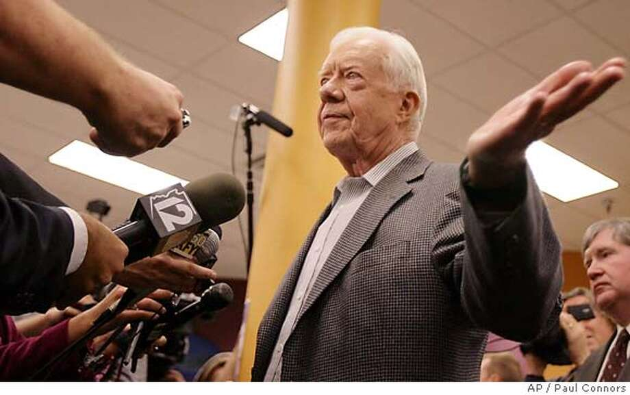 Former President Jimmy Carter answers reporters questions prior to signing copies of his new book at a bookstore in Tempe, Ariz., Tuesday, Dec. 12, 2006.(AP Photo/Paul Connors) Photo: PAUL CONNORS
