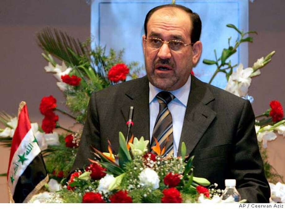 """Iraqi Prime Minister Nouri al-Maliki speeks during the National reconciliation conference in Baghdad's Convention Centre, Iraq, Saturday, Dec. 16, 2006. Al- Maliki said that Iraq's army has """"opened its doors"""" to all former members of Saddam Hussein's army, as the Shiite-dominated government reached out to Sunni Arabs for help in curbing the rampant violence in the country. (AP Photo/Ceerwan Aziz, Pool) POOL PHOTO Photo: CEERWAN AZIZ"""