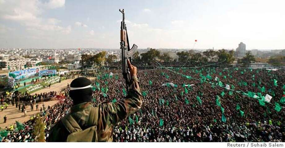 Palestinian Hamas supporters attend a Hamas rally in Gaza December 15, 2006. A top Hamas leader on Friday accused Palestinian President Mahmoud Abbas of Fatah of launching a war against the ruling Islamic militant group and said it would not agree to holding early elections. REUTERS/Suhaib Salem (GAZA)  Ran on: 12-16-2006  Hamas supporters attend a rally in Gaza. A Hamas leader has accused a Fatah lawmaker of organizing an assassination attempt on Prime Minister Ismail Haniyeh, a Hamas leader.  Ran on: 12-16-2006  Hamas supporters attend a rally in Gaza. A Hamas official has accused a Fatah lawmaker of organizing an assassination attempt on Prime Minister Ismail Haniyeh, a Hamas leader. Photo: SUHAIB SALEM