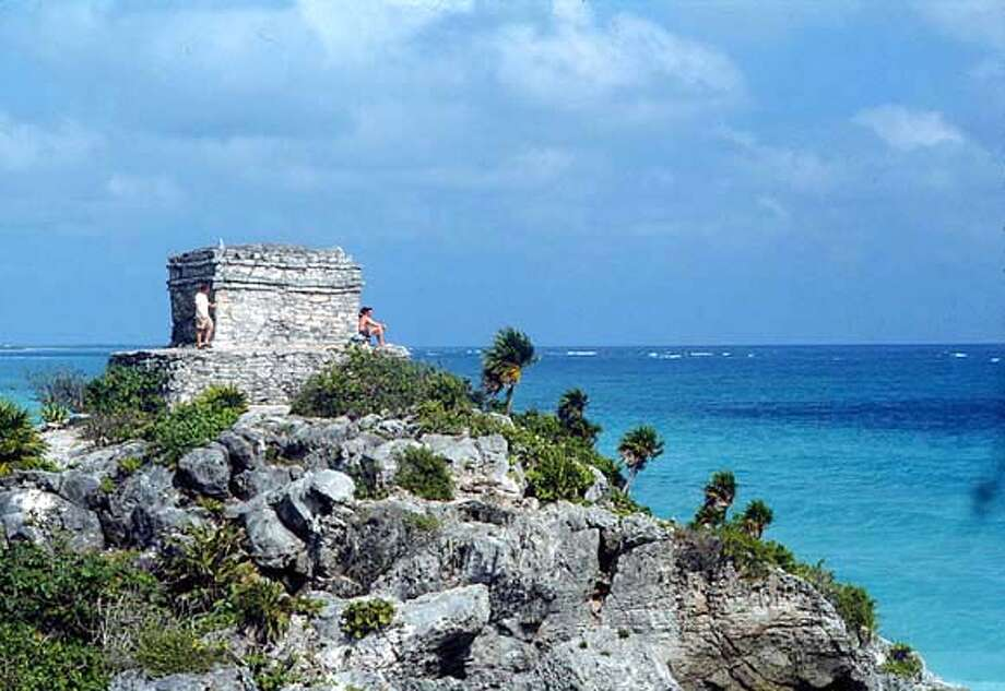 TRAVEL YUCATAN, Mexico -- Ruins on outcropping of Tulum archaeological ruins on Mexico's Yucatan coast.  Handout, file photo