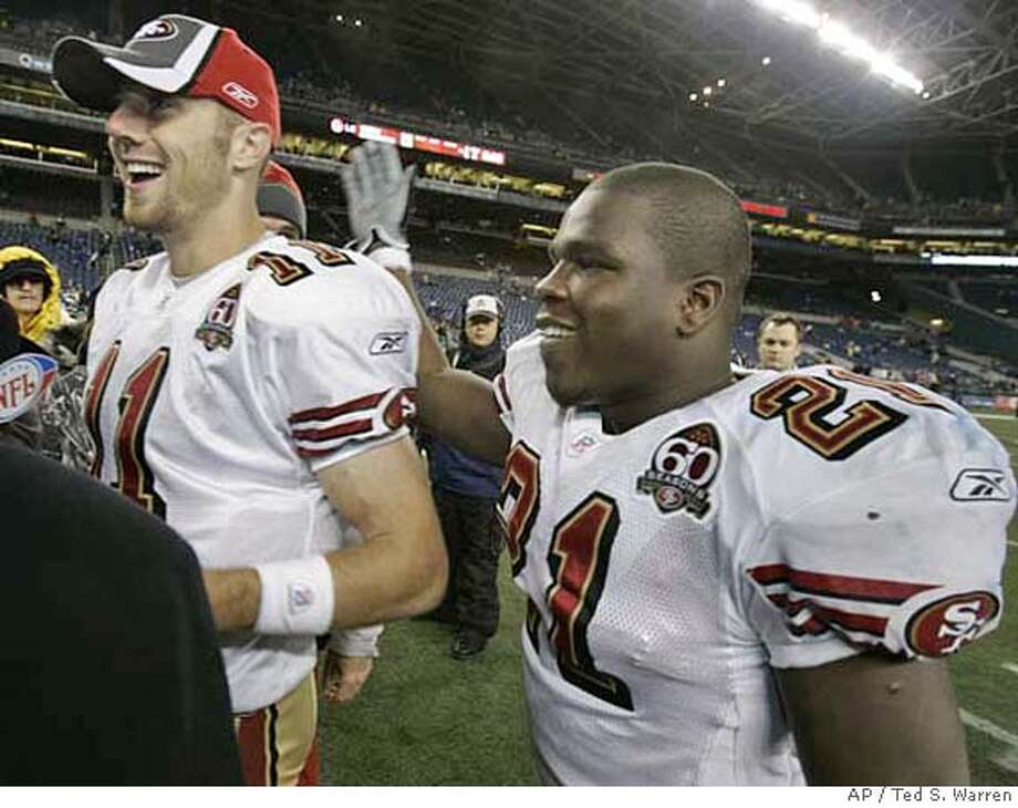 San Francisco 49ers quarterback Alex Smith, left, and running back Frank Gore, right, celebrate the 49ers' 24-14 win over the Seattle Seahawks Thursday, Dec. 14, 2006, at Qwest Field in Seattle. (AP Photo/Ted S. Warren) Photo: Ted S. Warren