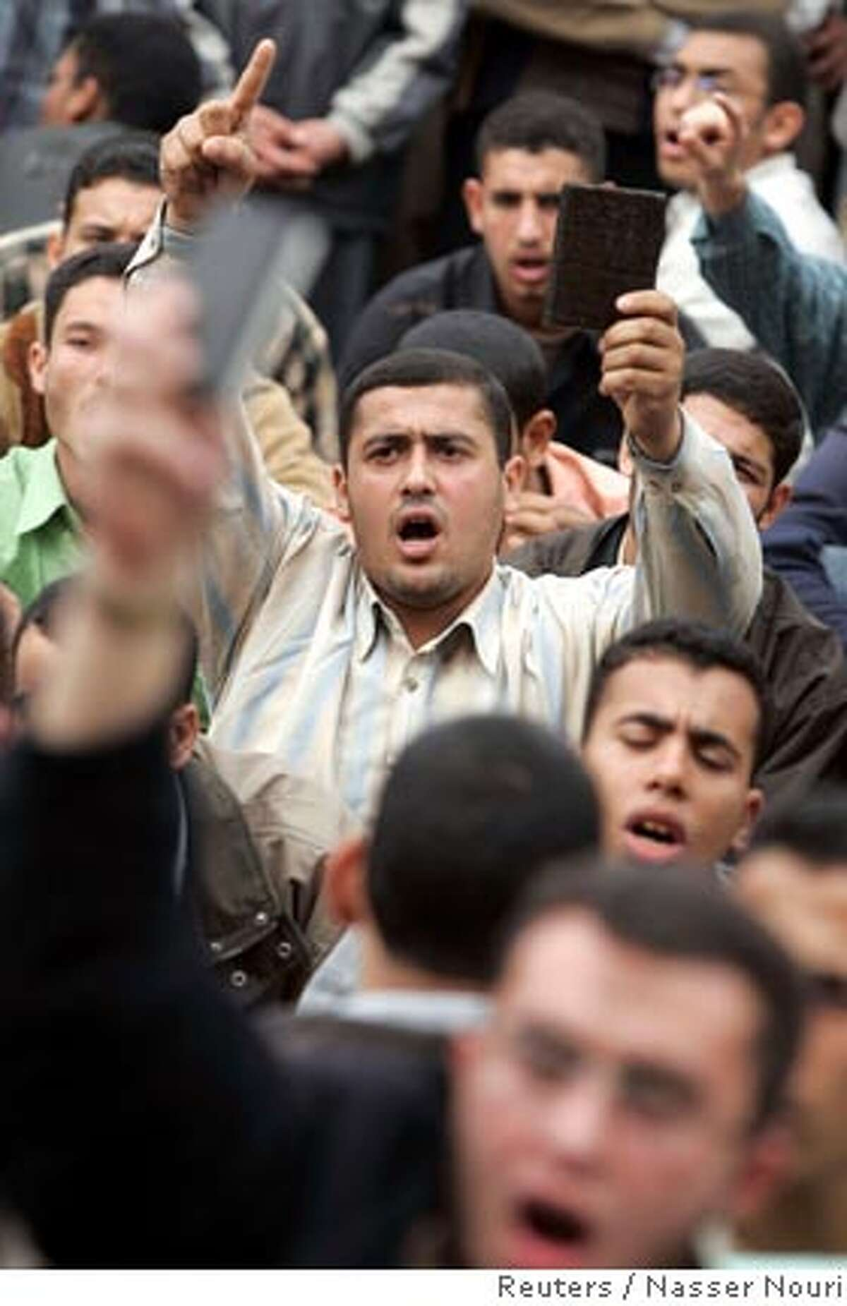 Muslim Brotherhood students protest at Al-Azhar University in Cairo December 14, 2006. Egyptian police detained the deputy leader of the opposition Muslim Brotherhood, about 10 prominent members and scores of Islamist students in dawn raids on Thursday, Brotherhood and police sources said. REUTERS/Nasser Nouri (EGYPT) Ran on: 12-15-2006 Muslim Brotherhood students protest at Al-Azhar University in Cairo. Some wore militant-type clothing with black face masks. Ran on: 12-15-2006 Muslim Brotherhood students protest at Al-Azhar University in Cairo. Some wore militant-type clothing with black face masks.