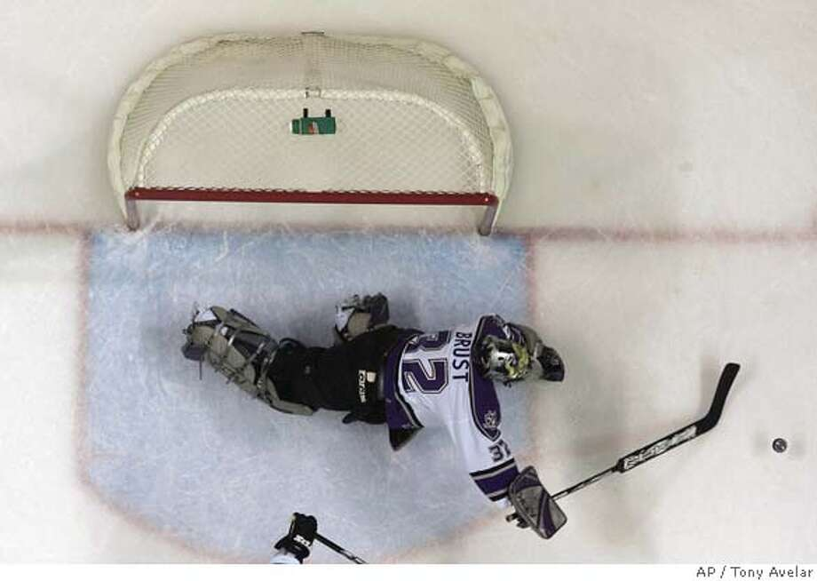 Los Angeles Kings goalie Barry Brust dives for the puck on a shot-attempt by San Jose Sharks during the second period of an NHL hockey game in San Jose, Calif., on Thursday, Dec. 14, 2006. (AP Photo/ Tony Avelar) Photo: TONY AVELAR