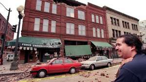 "David Arroya a janitor at Fenix Underground reacts after seeing the earthquake damage of the historic Pioneer Square building in Seattle. ""I hope I don't have to clean it up,"" he said. The picture was taken Feb. 28, 2001. (seattlepi.com file) (SEATTLE POST INTELLIGENCER)"
