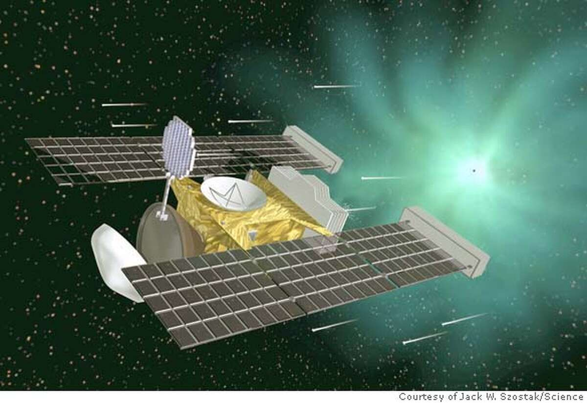 """clay03_sc0297a.jpg for clay03; Artist's rendering of the """"Stardust"""" spacecraft encountering the comet Wilde-2 to collect dust particles from the comet that were left over from the formation of the solar system more than 4 billion years ago. The spacecraft will return the dust particles to Earth as scientists seek to understand the origin of the earth and its life. Courtesy of Jack W. Szostak/Science / handout MANDATORY CREDIT FOR PHOTOG AND SF CHRONICLE/ -MAGS OUT Scientists have created a circular vesicle (green) with its RNA (red-orange) encapsulated within it on a mottled clay surface. Vesicles like this might have formed Earths first living cells. CAT Metro#Magazine#Chronicle#11/3/2003#ALL#3star##0421465849"""