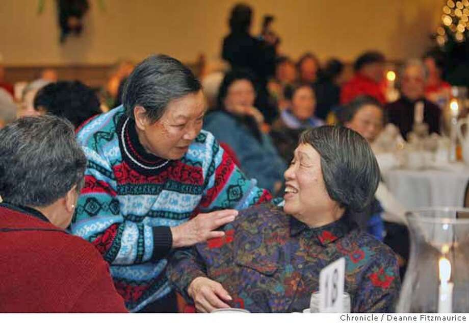 seniors_0078_df.jpg  Annie Chan (striped sweater at left) greets Ching Fung Young. Both are from the Chinese Community Recreation Center. The Cable Car Operators donated their time and money to put on a luncheon at the Golden Gateway Holiday Inn for seniors from senior centers around the city. Photographed in San Francisco on 12/14/06. (Deanne Fitzmaurice/ The Chronicle) Mandatory credit for photographer and San Francisco Chronicle. /Magazines out. Photo: Deanne Fitzmaurice