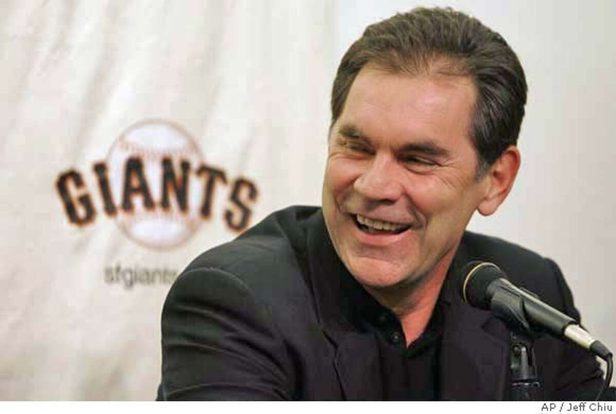 New San Francisco Giants manager Bruce Bochy smiles as he speaks at a news conference in San Francisco, Thursday, Dec. 14, 2006. (AP Photo/Jeff Chiu) EFE OUT