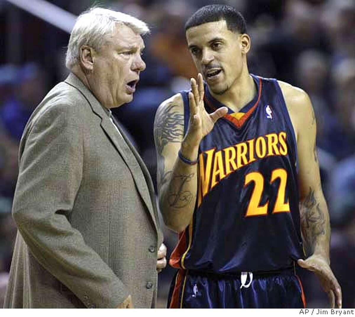 Golden State Warriors' head coach Don Nelson, left, and Matt Barnes talk in NBA basketball action in the fourth quarter against the Seattle SuperSonics Sunday, Dec. 10, 2006 in Seattle. The SuperSonics beat the Warriors 117-115. (AP Photo/Jim Bryant)