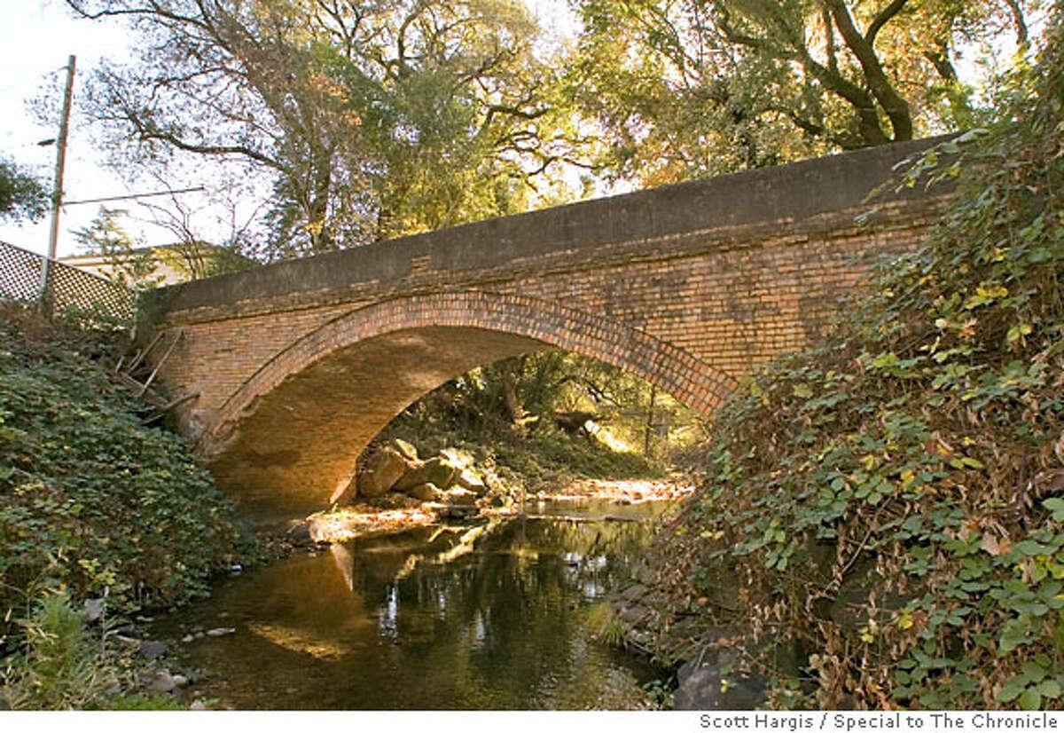 Masonry footbridge over creek beside