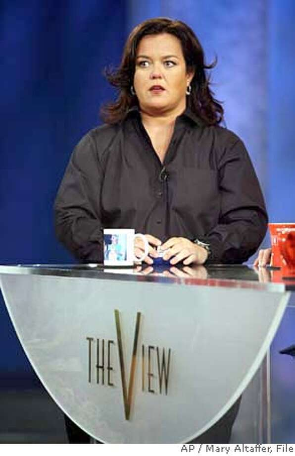 "**FILE** Rosie O'Donnell, fills the moderator slot on ""The View"" vacated by Meredith Vieira during the taping of the first show of the 10th season of the ABC women's chat show in this, Sept. 5, 2006 file photo, in New York. She's only been on ""The View"" for three months and already there are published rumors that Rosie O'Donnell wants out. She tried to shoot them down on Thursday. ""Don't anybody worry where Rosie's going,"" she said. ""She's right here."" (AP Photo/Mary Altaffer, file) **FILE** Photo: MARY ALTAFFER"