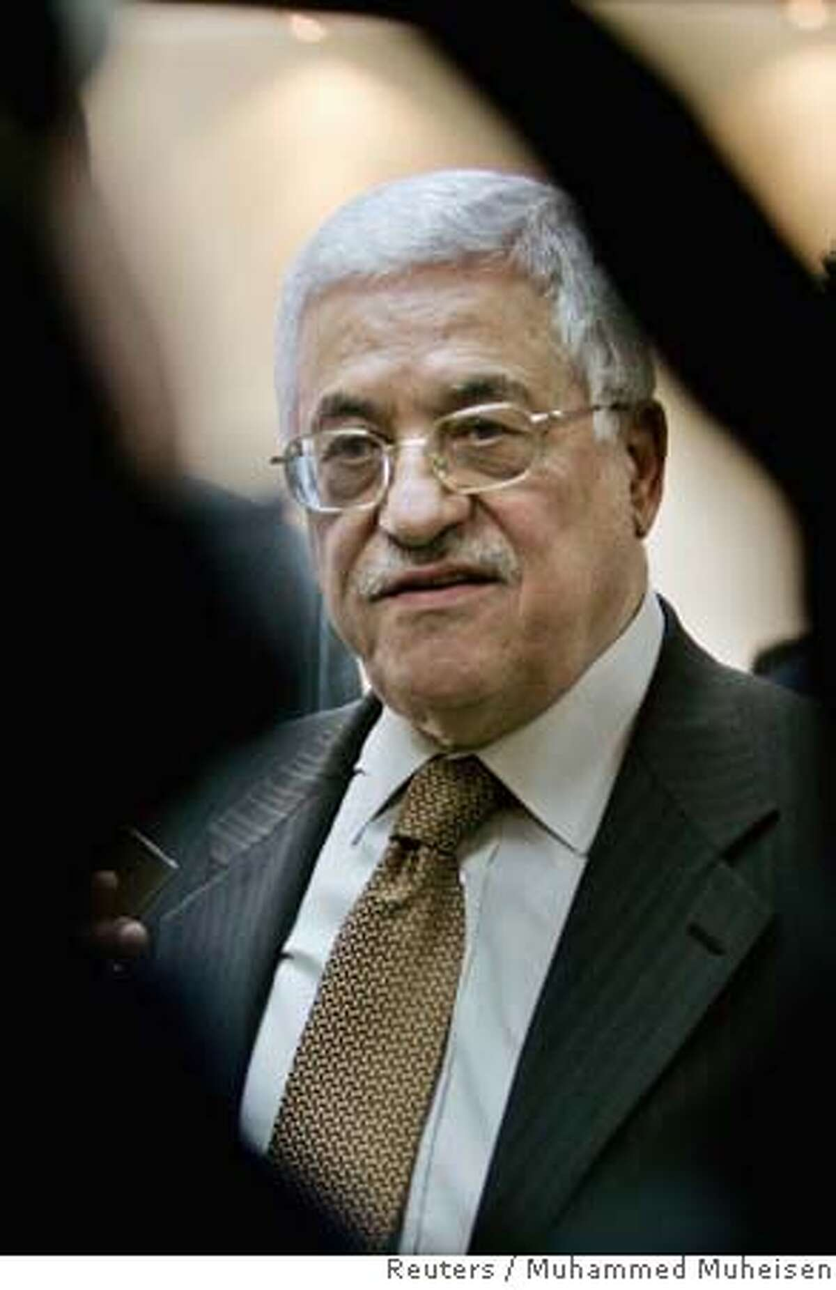 Palestinian President Mahmoud Abbas speaks to the media after a meeting in his office in the West Bank city of Ramallah December 11, 2006. Unidentified gunmen killed three sons of a Palestinian intelligence official loyal to Abbas in Gaza on Monday, firing at the car as it dropped them at school, police and hospital officials said. REUTERS//Muhammed Muheisen/Pool (WEST BANK) Ran on: 12-14-2006 The Presidential Guard has increased to 1,000, up from about 90 officers under Yasser Arafat.