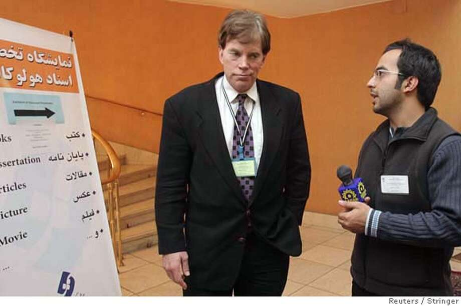 An Iranian journalist speaks with American David Duke (L), a former Ku Klux Klan leader, as he attends the international conference of 'Review of the Holocaust: Global Vision' in Tehran, December 12, 2006. Iran staged a conference on Monday to debate the Holocaust and question whether Nazi Germany used gas chambers, prompting charges it was encouraging the denial of the killing of 6 million Jews during World War Two. REUTERS/Stringer (IRAN) 0 Photo: STRINGER/IRAN
