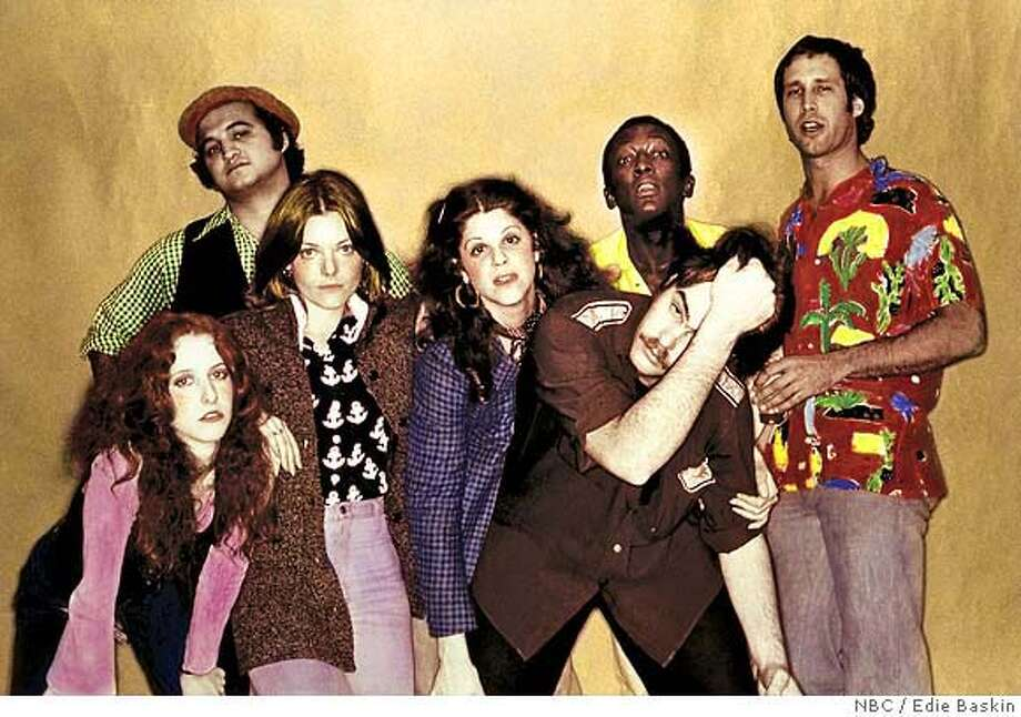 Courtesy of NBC Studios, Inc. / Photos by Edie Baskin  Ran on: 12-14-2006  &quo;SNL,&quo; back in the day: Laraine Newman (from left), John Belushi, Jane Curtin, Gilda Radner, Dan Aykroyd, Garrett Morris and Chevy Chase. Photo: Ho