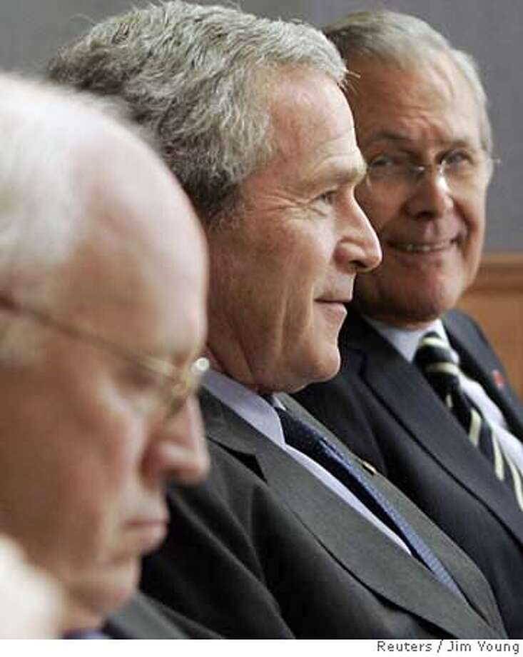 U.S. President George W. Bush (C) is joined by Vice President Dick Cheney (L) and outgoing Secretary of Defense Donald Rumsfeld during a meeting with Department of Defense officials on Iraq at the Pentagon in Washington December 13, 2006. REUTERS/Jim Young (UNITED STATES) 0 Photo: JIM YOUNG