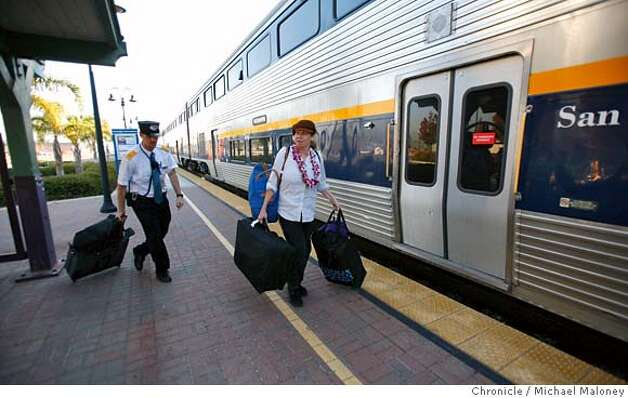 Debbie Mills of Huntington Beach, CA boards a westbound Capitol Corridor train in Hayward. Helping her with her bags is Capitol Corridor's Matt Zundel. Mills was in Danville visiting relatives, prior to heading back home.  The Capitol Corridor, a train service run by parts of nearly a dozen agencies, shouldn't work. Too many bureaucrats have their hands in it and it relies on tracks heavily traveled by freight trains. But the increasingly popular commuter train service turns 15 this month and its popularity is soaring.  Photo by Michael Maloney / San Francisco Chronicle MANDATORY CREDIT FOR PHOTOG AND SF CHRONICLE/ -MAGS OUT Photo: Michael Maloney