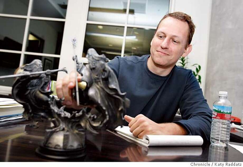 FOUNDERFUND_038_RAD.jpg  SHOWN: Peter Thiel, one of the founding partners of The Founders Fund, in his office with a cool Lord of the Rings sculpture. These photos were made on Monday, Dec. 11, 2006, in San Francisco, CA.  (Katy Raddatz/SF Chronicle)  * Peter Thiel Mandatory credit for the photographer and the San Francisco Chronicle. ; mags out. Photo: Katy Raddatz