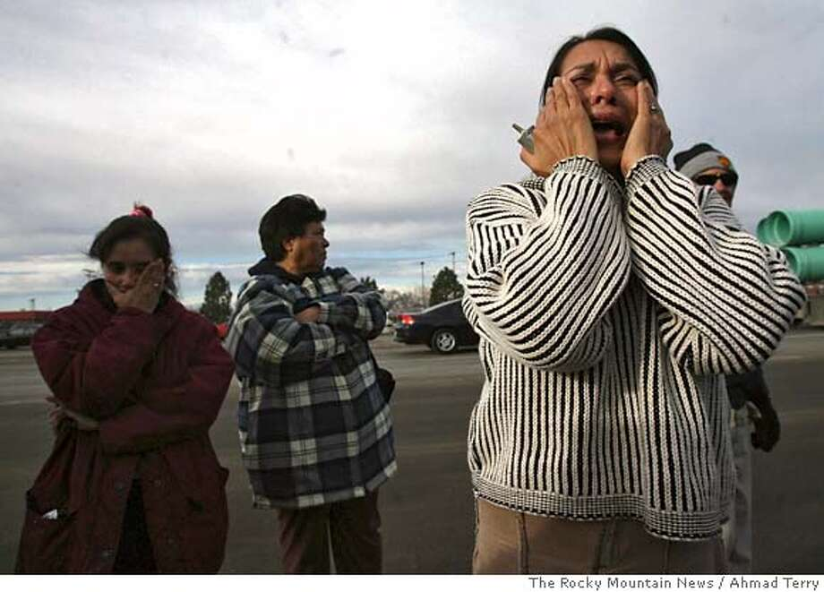 ** CORRECTS SPELLING OF PHOTOGRAPHER'S LAST NAME ** Marta Granillo, right, cries for her husband, relatives and friends, who are being arrested during a raid by federal officials, Tuesday Dec. 12, 2006, at a Swift meat processing plant in Greeley, Colo. Federal agents raided meat processing plants in six states Tuesday and arrested an unknown number of suspected illegal immigrants in an identity theft investigation, temporarily suspending operations at all six plants. (AP Photo/The Rocky Mountain News, Ahmad Terry )*MAGS OUT** **TV OUT** **MANDATORY CREDIT** **INTERNET OUT** CORRECTS SPELLING OF PHOTOGRAPHER'S LAST NAME **DENVER OUT** **MAGS OUT** **TV OUT** **MANDATORY CREDIT** **INTERNET OUT** Photo: AHMAD TERRY