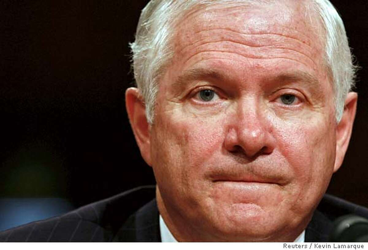 U.S. Defense Secretary nominee Robert Gates testifies before the U.S. Senate Armed Services Committee during his confirmation hearing on Capitol Hill in Washington December 5, 2006. REUTERS/Kevin Lamarque (UNITED STATES) 0