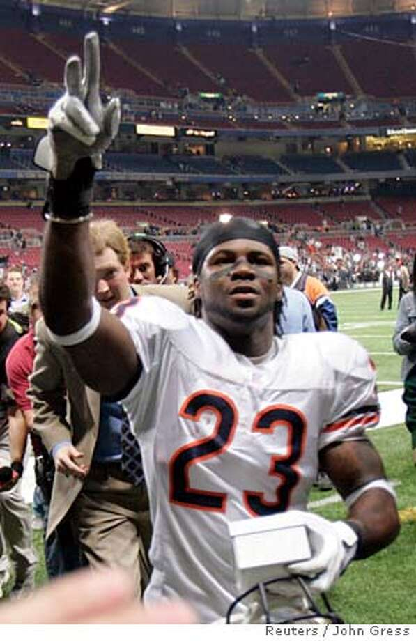 Chicago Bears corner back Devin Hester celebrates after defeating the St. Louis Rams in their NFC NFL football game in St. Louis, Missouri, December 11, 2006. REUTERS/John Gress (UNITED STATES)  Ran on: 12-13-2006  Devin Hester, left, the Chicago Bears' return man, and Vince Young, below, the Tennessee Titans' quarterback, have plenty to celebrate. Both are among this year's rookie sensations.  Ran on: 12-13-2006  Devin Hester, left, the Chicago Bears' return man, and Vince Young, below, the Tennessee Titans' quarterback, have plenty to celebrate. Both are among this year's rookie sensations. Photo: JOHN GRESS