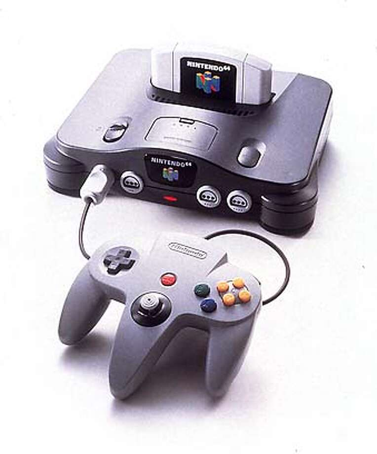 �NINTENDO'S NEW GAMING SYSTEM WILL OFFER 64 BYTES AND A CLAW SHAPED CONTROL UNIT SPORTING A JOY STICK. ALSO APPEARED 9/28/96 CAT Photo: Ho