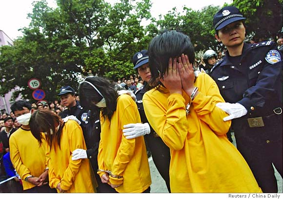 china in uproar over perp walk for prostitutes    police