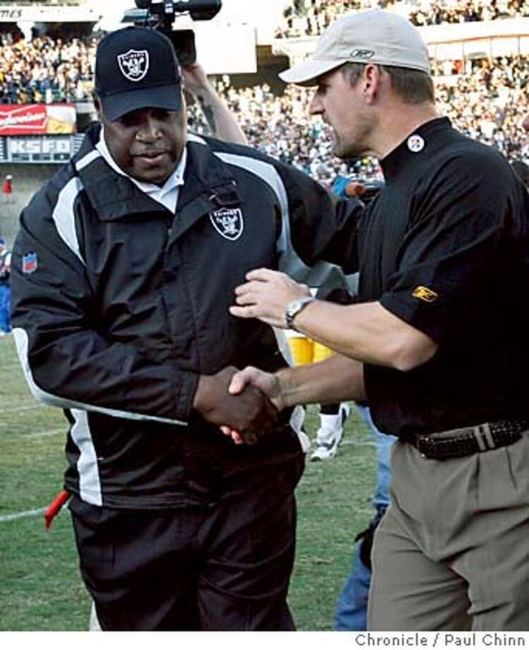 Art Shell and Pittsburgh head coach Bill Cowher meet at midfield at the end of the Oakland Raiders vs. Pittsburgh Steelers game at McAfee Coliseum in Oakland, Calif. on Sunday, Oct. 29, 2006.  PAUL CHINN/The Chronicle  **Art Shell, Bill Cowher MANDATORY CREDIT FOR PHOTOGRAPHER AND S.F. CHRONICLE/ - MAGS OUT Photo: PAUL CHINN