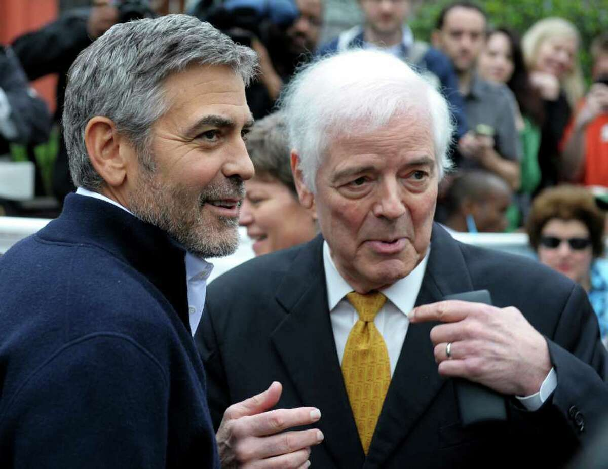 Actor George Clooney, left, and his father Nick Clooney, take part in a protest at the Sudan Embassy in Washington, Friday, March 16, 2012. The demonstrators are protesting the escalating humanitarian emergency in Sudan that threatens the lives of 500,000 people.