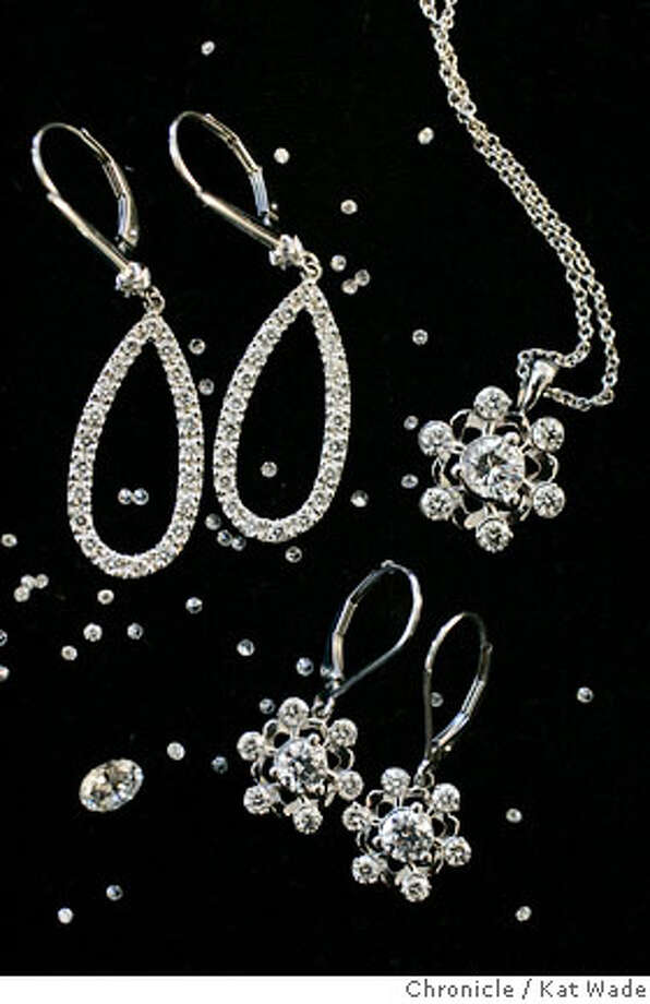 "DIAMONDS_0027_KW_.jpg A display consisting of Pear Drop Diamond earrings, Diamond snowflake earrings and matching pendant, a 1 carat round brilliant diamond, and a scattering of small round .015 carat brilliant diamonds belonging to Beth Gerstein and Eric Grossberg (NOT PICTURED) co-owners of Brilliant Earth, a company that sells ""conflict free diamonds"" from Canada in their San Francisco office on Tuesday December 5, 2006 . Ran on: 12-10-2006  &quo;Conflict free diamonds,&quo; such as these from Brilliant Earth, left, have drawn controversy. Some, like John Moriarty, owner of 14 Karats in Berkeley, say that &quo;blood diamonds&quo; are a thing of the past.  Ran on: 12-09-2006 Photo: Kat Wade"