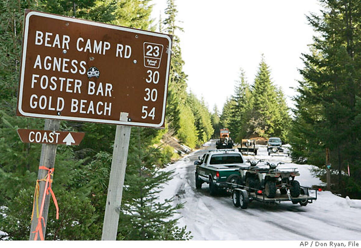 Search crews with all terrain vehicles head down Bear Camp Road in the Siskyou National Forest near Galice, Ore., Tuesday, Dec. 5, 2006, near where the Kim family became stranded in snow. Kati Kim and her two children were found in good health Monday by a helicopter, but James Kim, who tried to hike out, is still missing as of Tuesday morning.(AP Photo/Don Ryan)