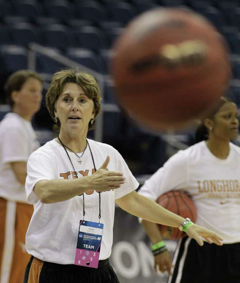 Texas head coach Gail Goestenkors directs her team during practice in Norfolk, Va., Friday, March 16, 2012. Texas plays West Virginia in an NCAA tournament first-round women's college basketball game on Saturday.   (AP Photo/Steve Helber) Photo: Steve Helber / AP