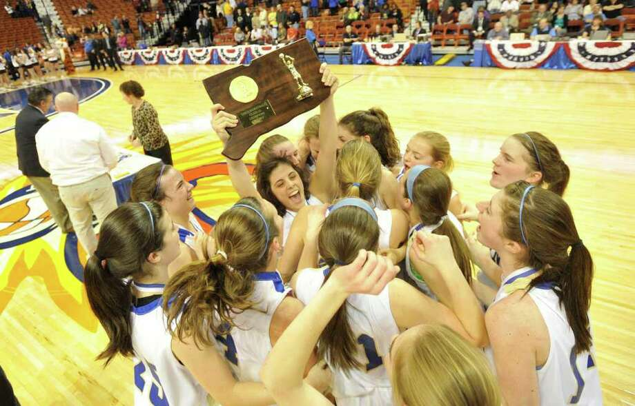 The Newtown girls basketball team celebrate their 44-42 win over Mercy in the Class LL championship game at Mohegan Sun Arena in Uncasville on Friday, March 16, 2012. Photo: Jason Rearick / The News-Times