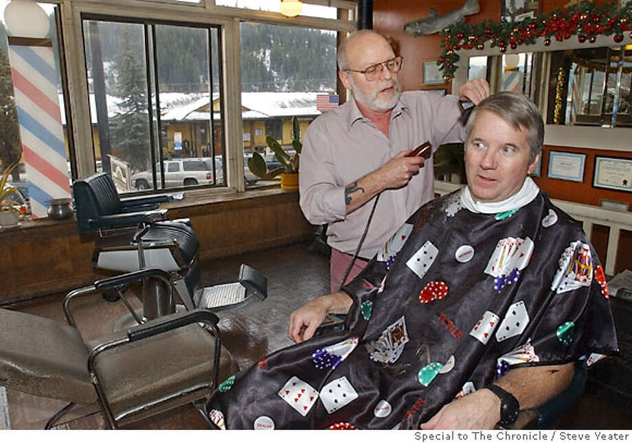 Jim McAmis, seated, get his hair cut by John Curtis at Manstyle Barbers in Truckee, Calif., on Friday, Dec. 8, 2006.(Photo/Steve Yeater) Photo: Steve Yeater