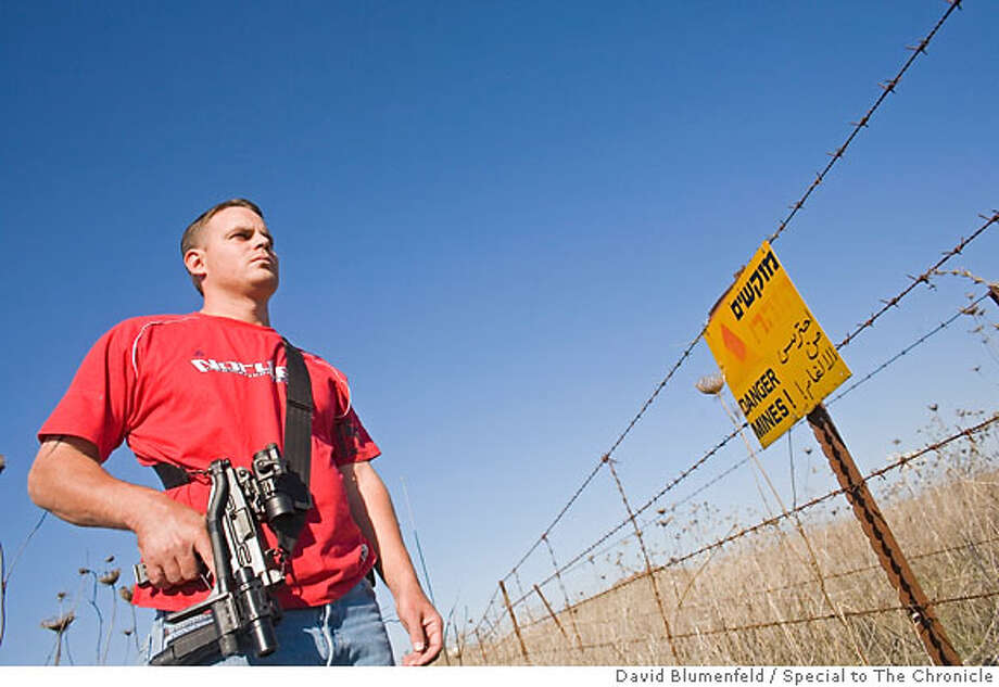 Golan Heights, near Syrian Border: Volunteer Border Guard, Jamie Ben David looks out onto a minefield near the border with Syria in the Golan Heights.  David Blumenfeld/Special to The Chronicle  Ran on: 12-10-2006  Jamie Ben-David, a San Diego native living in Israel, polices along a minefield in the Golan Heights, near the Syrian border. Photo: David Blumenfeld