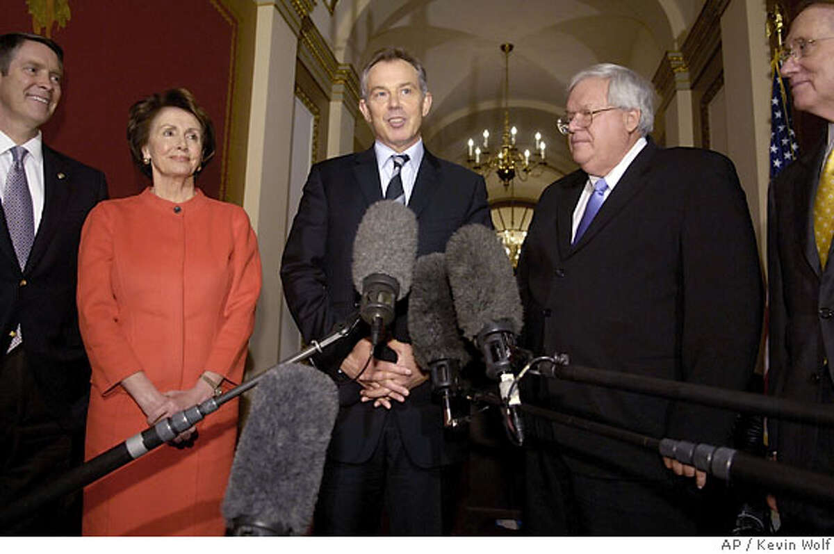 British Prime Minister Tony Blair, center, accompanied by, from left, outgoing Senate Majority Leader Bill Frist of Tenn., incoming House Speaker Nancy Pelosi of Calif., outgoing House Speaker Dennis Hastert of Ill., and incoming Senate Majority Leader Harry Reid of Nev., meets reporters on Capitol Hill in Washington, Thursday, Dec. 7, 2006. (AP Photo/Kevin Wolf)