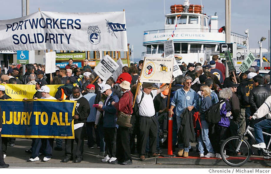 ilwu10_091_mac.jpg ILWU, Inland Boatmen and members of other waterfront unions picket outside the gates of Hornblower Cruises at Pier 33. Terry MacRae's nonunion Hornblower Cruises and Events has taken over the Alcatraz Ferry from the union Blue and Gold Fleet, which lost the contract with the National Park Service. Trouble on the waterfront now may be escalating. ILWU, Inland Boatmen and members of other waterfront unions have called a mass picket at Hornblower offices along the embarcadero at Pier 33. Event in, San Francisco, Ca, on 12/9/06. Photo by: Photo: Michael Macor