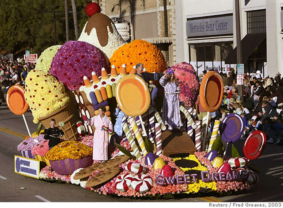 "The Optimist International's ""Sweet Dreams,"" one of 117 parade participants, passes by in the 114th Rose Parade in Pasadena, California, January 1, 2003. More than 10,000 chrysanthemums, straw flowers, carnations, lotus pods, marigolds and mums were used to construct the float. REUTERS/Fred Greaves Photo: FRED GREAVES"