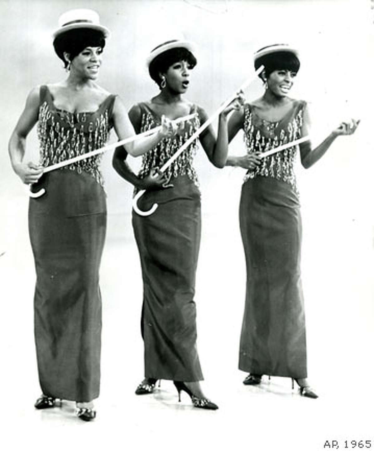 Detroit trio known as the Supremes have become a million-dollar enterprise in the space of a year through a combination of glamour trappings and a new rock n roll sound. They're pictured during a routine they'll do on an upcoming Red Skelton television show. Left to right: Florence Ballard, Mary Wilson, Diana Ross AP Wire photo 1965 Chronicle Archive Library