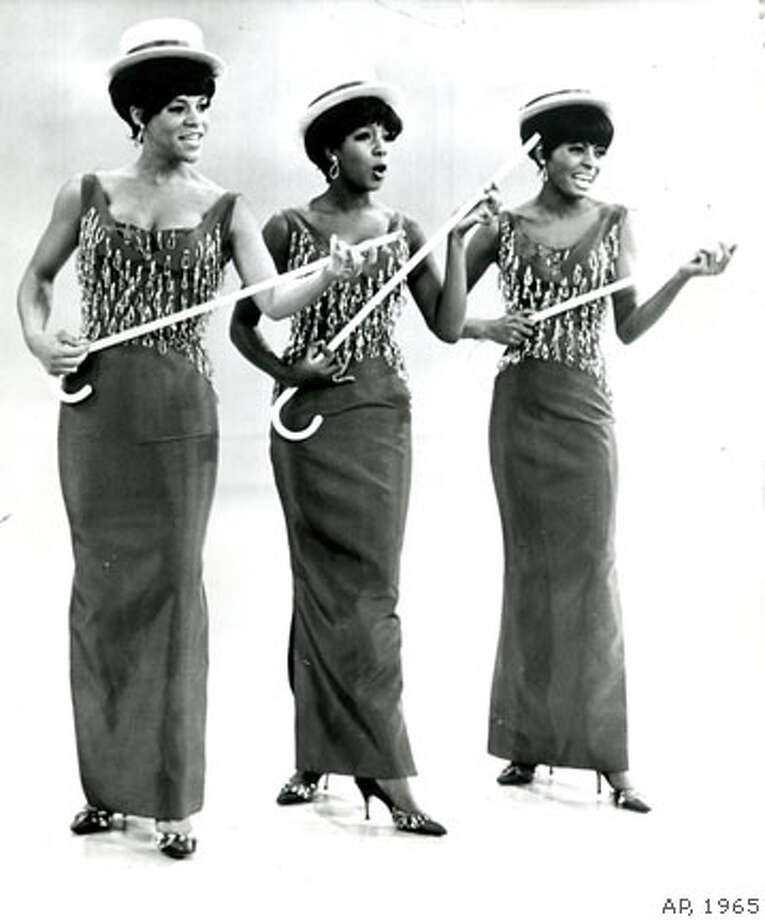 Detroit trio known as the Supremes have become a million-dollar enterprise in the space of a year through a combination of glamour trappings and a new rock n roll sound. They're pictured during a routine they'll do on an upcoming Red Skelton television show. Left to right: Florence Ballard, Mary Wilson, Diana Ross AP Wire photo 1965  Chronicle Archive Library Photo: Chronicle Photo Archive
