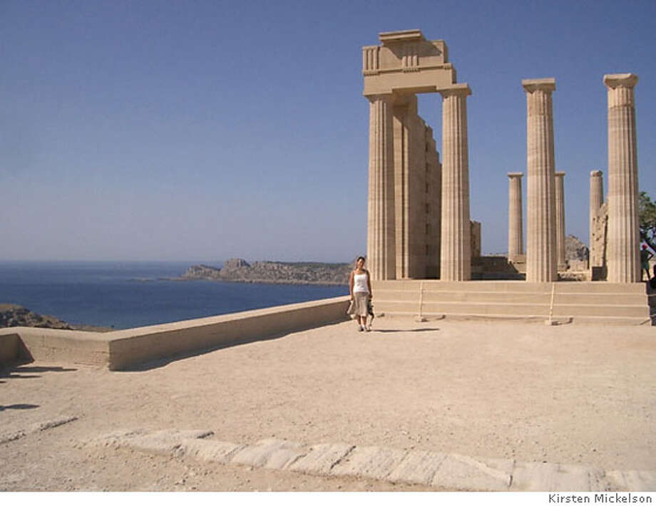 Dec. 10  TRAVEL JUSTBACK -- Kirsten Mickelson in front of the Lindos Acropolis in Rhodes (Lindos), Greece. 11/20/06 in , . / Special to The Chronicle Photo: Kirsten Mickelson