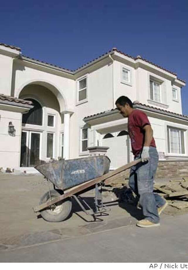 """Bulky """"McMansion"""" homes, like this one in Yorba Linda (Orange County), use more natural resources and waste building materials. Associated Press photo by Nick Ut"""
