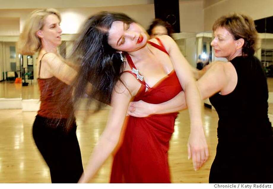 """TANGO_048_RAD.jpg  SHOWN: Tango. Pier Voulkos (blond), Chelsea Eng (red dress), Debbie Goodwin (wears black), Christy Cote (almost hidden, in rear), all rehearsing. We photograph a rehearsal at the Metronome Dance Center where all four directors and creators work together on a dance piece called """"Embrace."""" Story is about the big tango festival called The Leading Ladies of Tango. These pictures were made on Tuesday, Nov. 21, 2006, in San Francisco, CA.  (Katy Raddatz/SF Chronicle)  *Christy Cote, Pier Voulkos, Debbie Goodwin, Chelsea Eng Mandatory credit for the photographer and the San Francisco Chronicle. ; mags out. Photo: Katy Raddatz"""